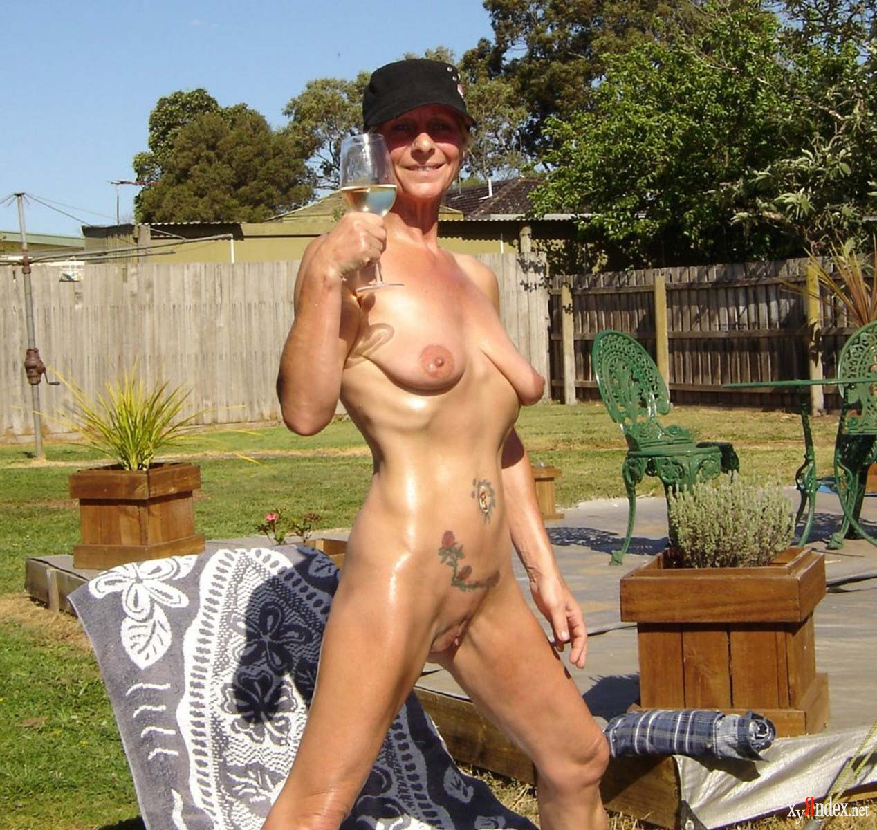Women nude in the backyard, fucked spread eagle from behind