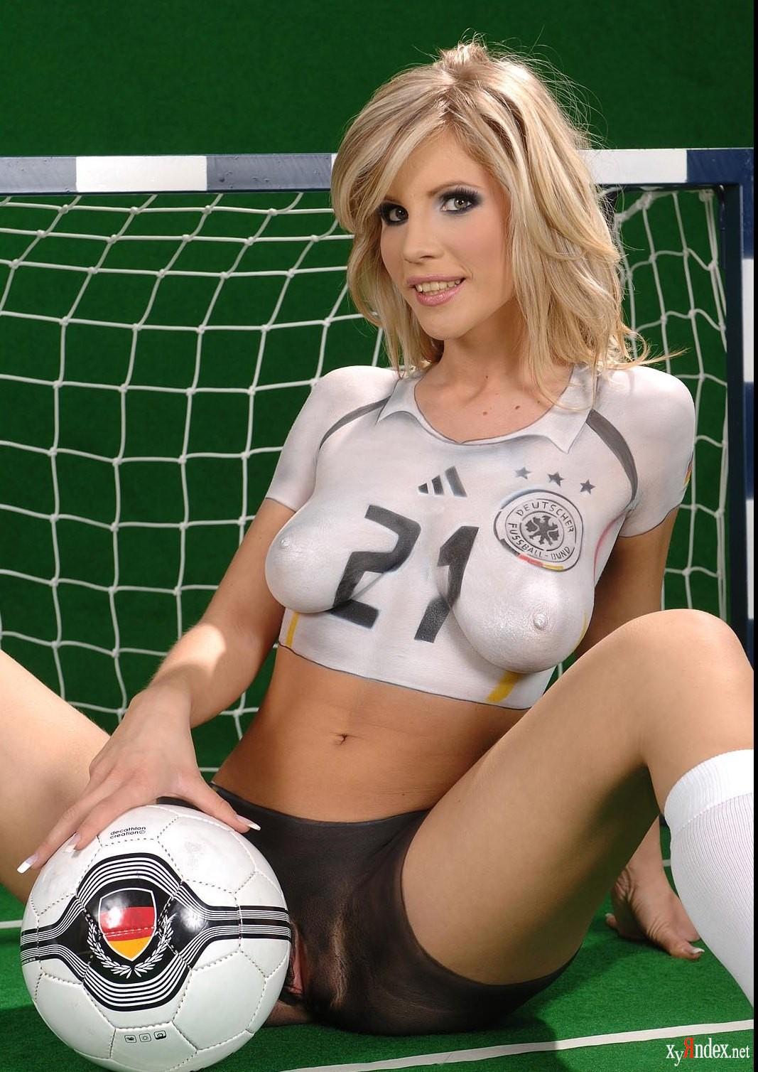 A nude girl playing football