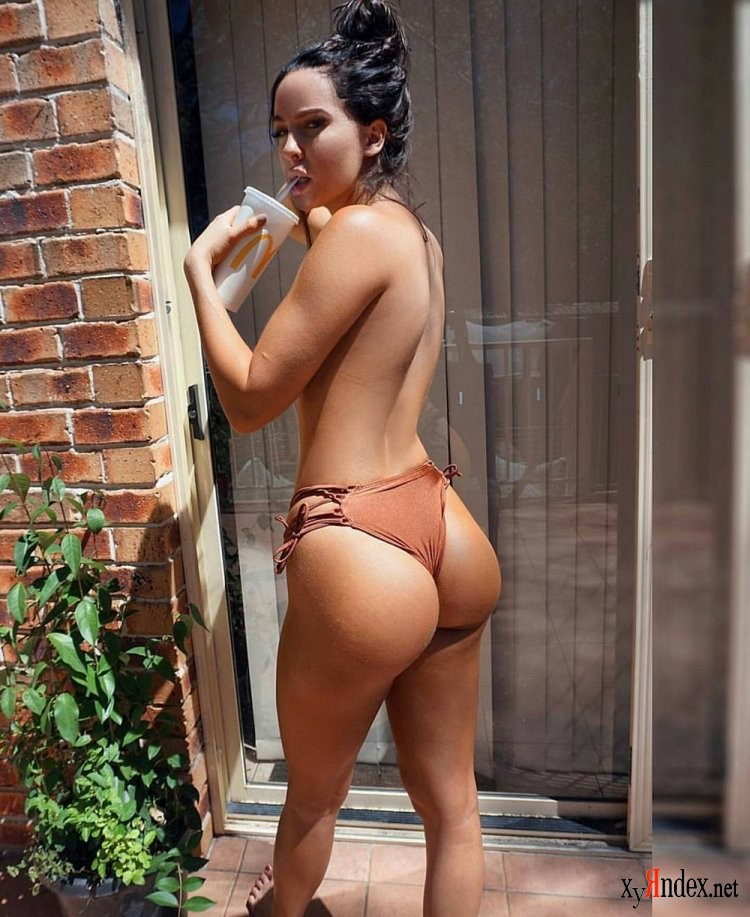Female in bikini with big butt, girl with big bum looking