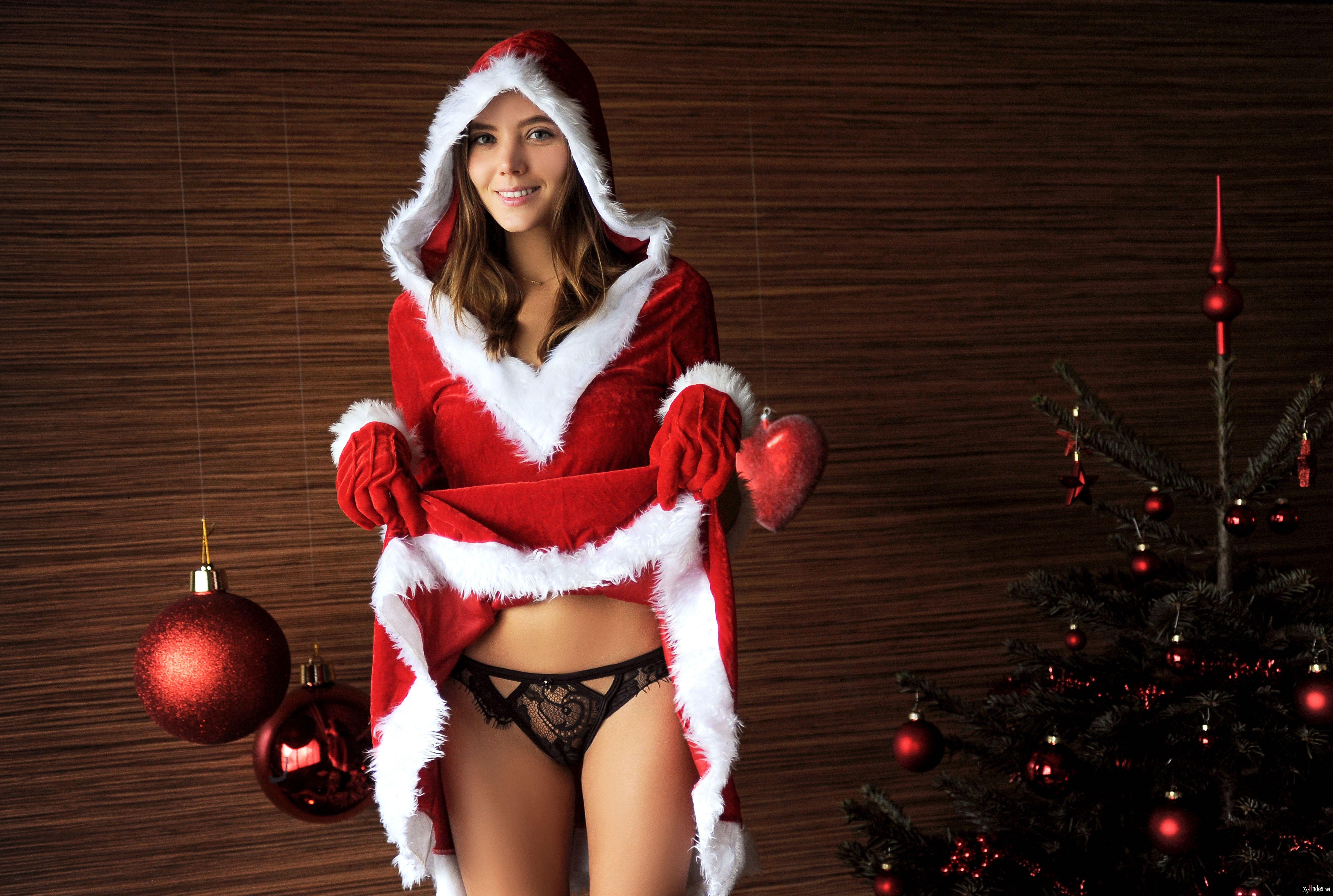 Santa claus is holding shrunken red santa suit pants stock photo