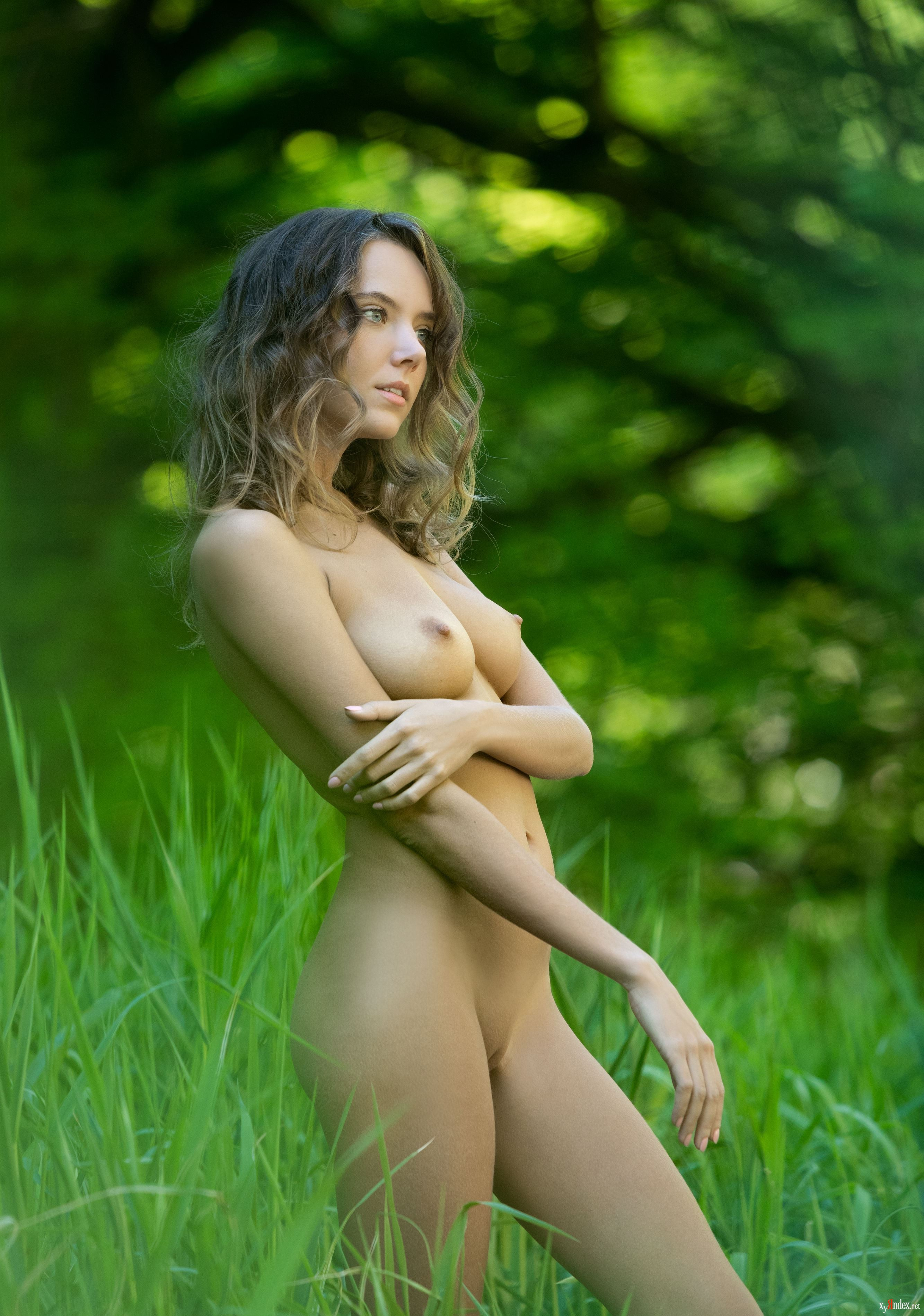 Ebony woman with natural naked chest willingly