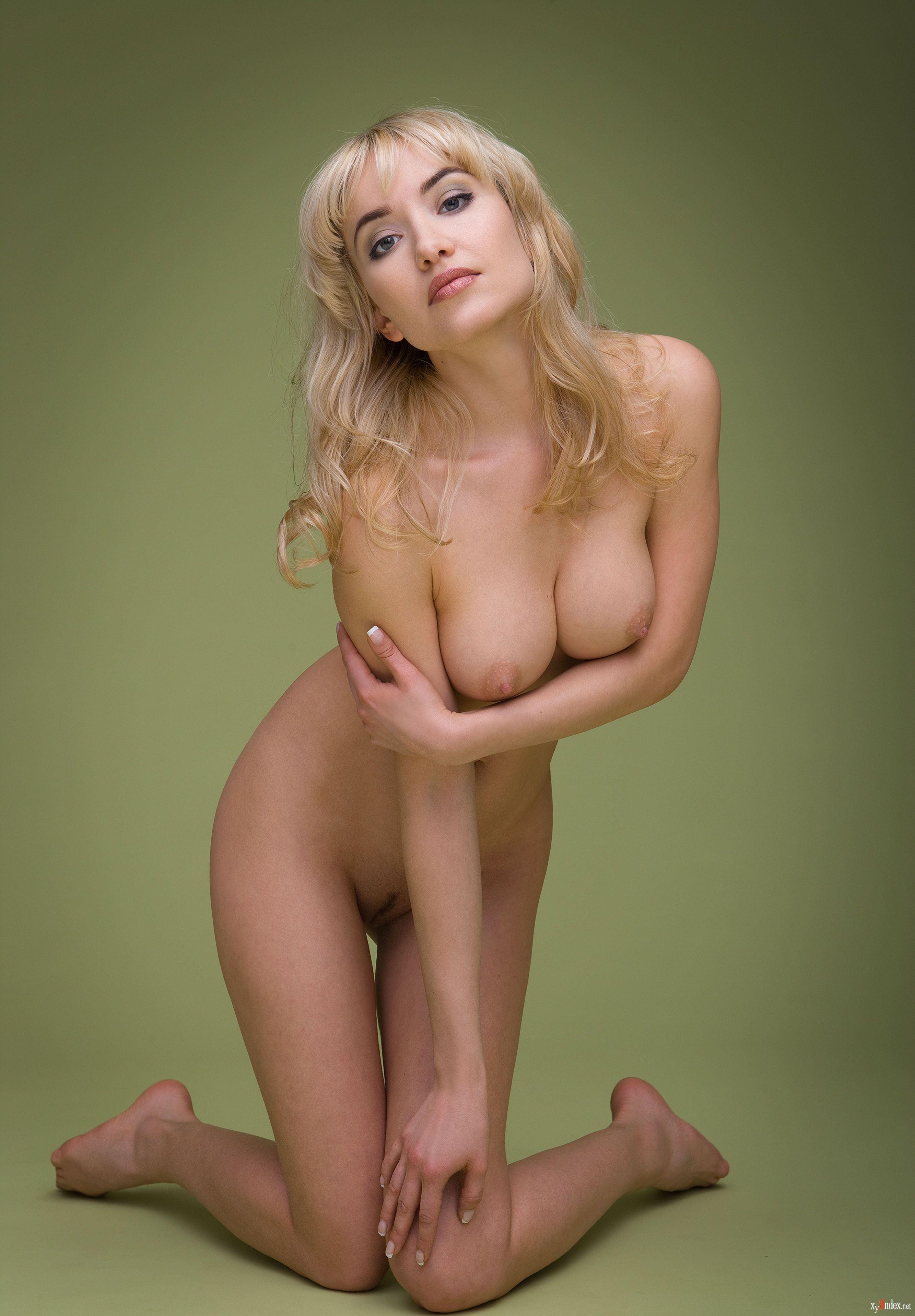 Beautiful statuesque blonde posing nude stock photo